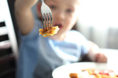 Child while eating Royalty Free Stock Photos