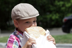 Child eating loaf of bread Royalty Free Stock Photo