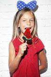 Child eating lollipop stock images