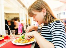 Child eating for lunch calamares Stock Photos