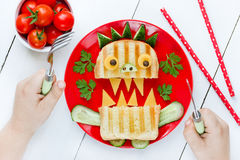 Child eating monster sandwich for breakfast. Funny idea for scho Royalty Free Stock Image