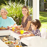 Child eating with mother Royalty Free Stock Photo