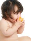 Child eating orange Royalty Free Stock Image