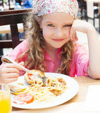 Child eating pasta. At cafe royalty free stock photos
