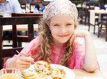 Child eating pasta Stock Photo