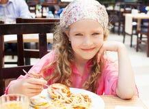 Child eating pasta Stock Photo