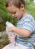 Child eating popcorn outdoor Stock Photo