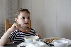 Child eating porridge Stock Photos
