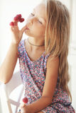 Child eating raspberries Royalty Free Stock Photo