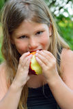 Child eating a red apple Stock Photos