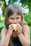 Child eating a red apple Royalty Free Stock Image
