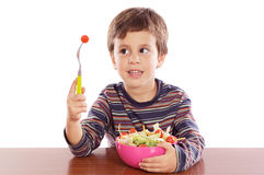 Child eating salad Royalty Free Stock Photos