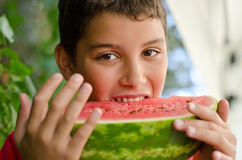 Child eating a slice of watermelon Royalty Free Stock Photography