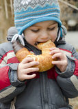 Child eating snack outdoors Royalty Free Stock Photography