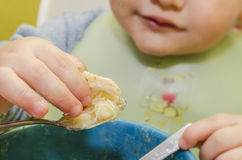 Child eating soup Royalty Free Stock Image