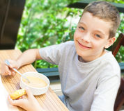 Child eating soup Royalty Free Stock Photos