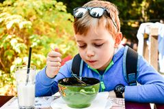 Child eating a soup royalty free stock image