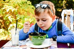 Child eating a soup stock image