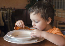 Child eating soup. In a restaurant royalty free stock images