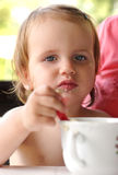 Child eating with spoon Royalty Free Stock Images