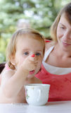 Child eating with spoon Stock Photography