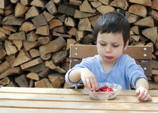 Child eating strawberries Royalty Free Stock Images