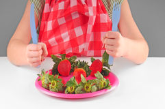 Child eating strawberries Royalty Free Stock Photography