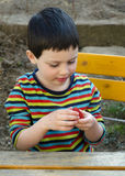 Child eating strawberry Stock Photography