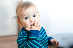 Child eating sugar. Child finger takes sugar and eat it delicious and fun Stock Image