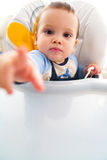 Child at eating table Royalty Free Stock Photos