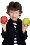 Child eating two apples Stock Photos