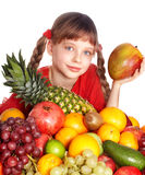 Child eating vegetable and fruit. royalty free stock photo