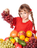 Child eating vegetable and fruit. Royalty Free Stock Images