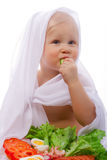 Child eating vegetables. A young child eating a salad of fresh vegetables Royalty Free Stock Photos