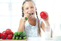 Child eating vegetables Royalty Free Stock Image