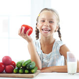 Child eating vegetables Royalty Free Stock Photography