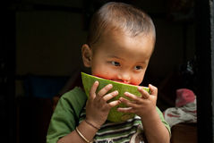 Child eating watermelon Stock Photography