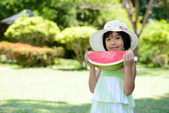 Child eating watermelon Stock Photo