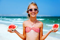 Child eating watermelon on the beach Royalty Free Stock Images