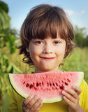 child eating watermelon in the garden Royalty Free Stock Photo
