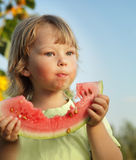 Child eating watermelon in the garden Royalty Free Stock Images