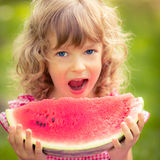 Child eating watermelon Stock Photos