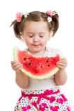 Child eating watermelon isolated Stock Image