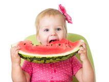 Child girl eating watermelon isolated on white background Stock Photos