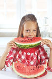 Child eating watermelon Stock Image