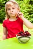 Child eating wild cherry Royalty Free Stock Image