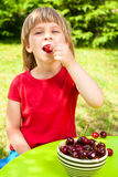 Child eating wild cherry Stock Photo