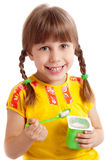 Child eating yogurt Royalty Free Stock Photo