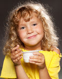 Child eating yogurt Stock Image