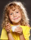 Child eating yogurt. Little happy child eating yogurt Stock Image